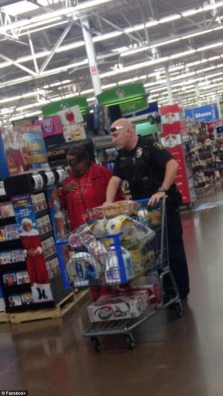 Officer Holder takes Dorothy Shephard grocery shopping for Thanksgiving.